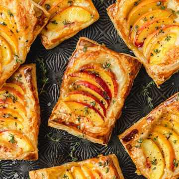 close up shot of peach thyme tarts