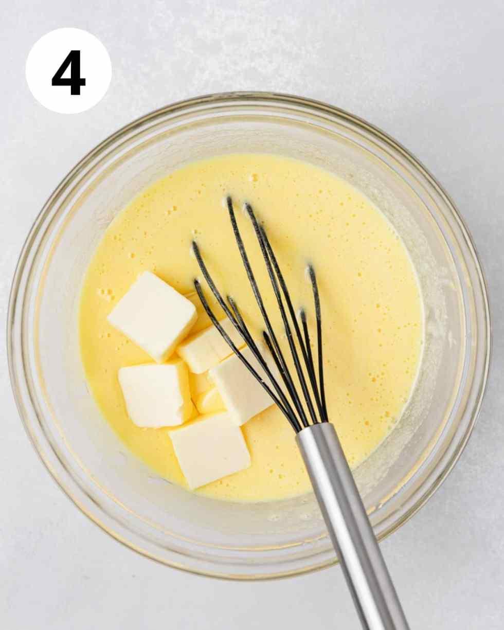 adding butter to lemon curd