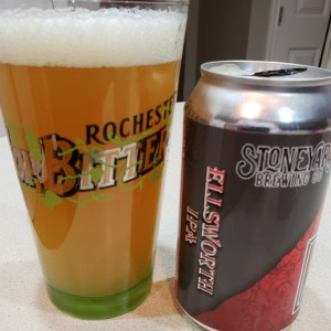 "A can of Ellsworth IPA from Stoneyard, poured into a Rochester Red Wings ""Hop Bitters"" pint glass."