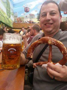 Ceetar with half a giant pretzel and a beer at Oktoberfest
