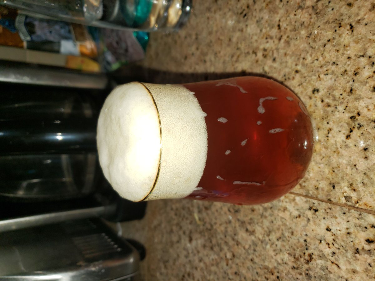 An overflowed beer glass