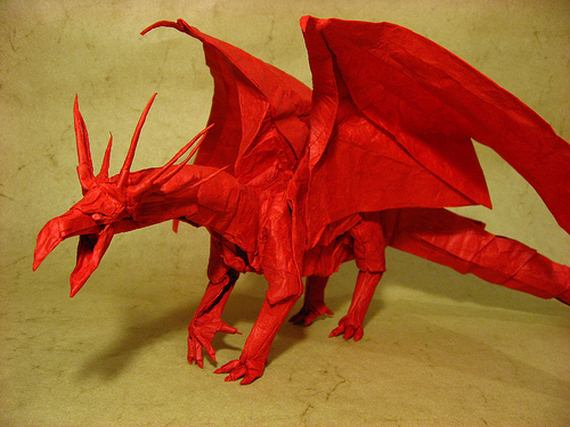 An origami dragon, folded out of red paper.