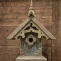 Gothic birdhouse mounted on wood