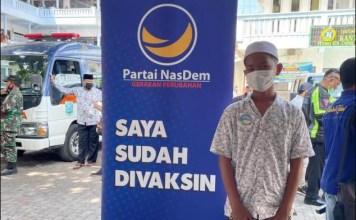 VAKSINASI: Nasdem Jatim vaksinasi di Ponpes Zainul Hasan Genggong, Kabupaten Probolinggo.   Foto: Barometerjatim.com/IST
