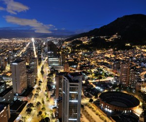 Panoramic night view of Bogota, the capital of Colombia, of the Avenida Carrera Septima with the bullring Santa Maria.