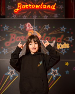 Little girl wearing Barrowland black kids hooded top.