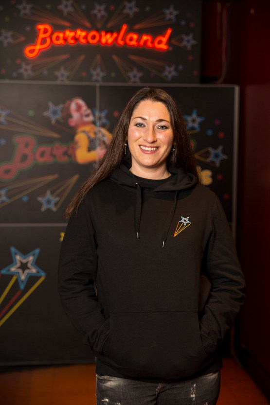 Lady showing front print of black Barrowland hooded top