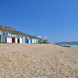 A row of colourful beach buts in milford on sea