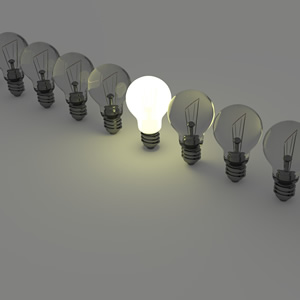 Light bulbs in a row with a single one lit