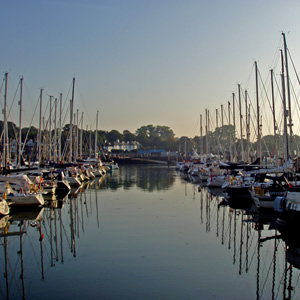 Lymington Solent at sunrise with still water and lots of boats in the harbour