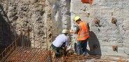 men inspecting foundation