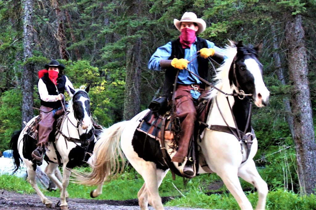 The outlaws try to stop the wagons from getting to the chuck wagon dinner up Cache Creek Canyon.