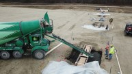 Concrete being poured at job site