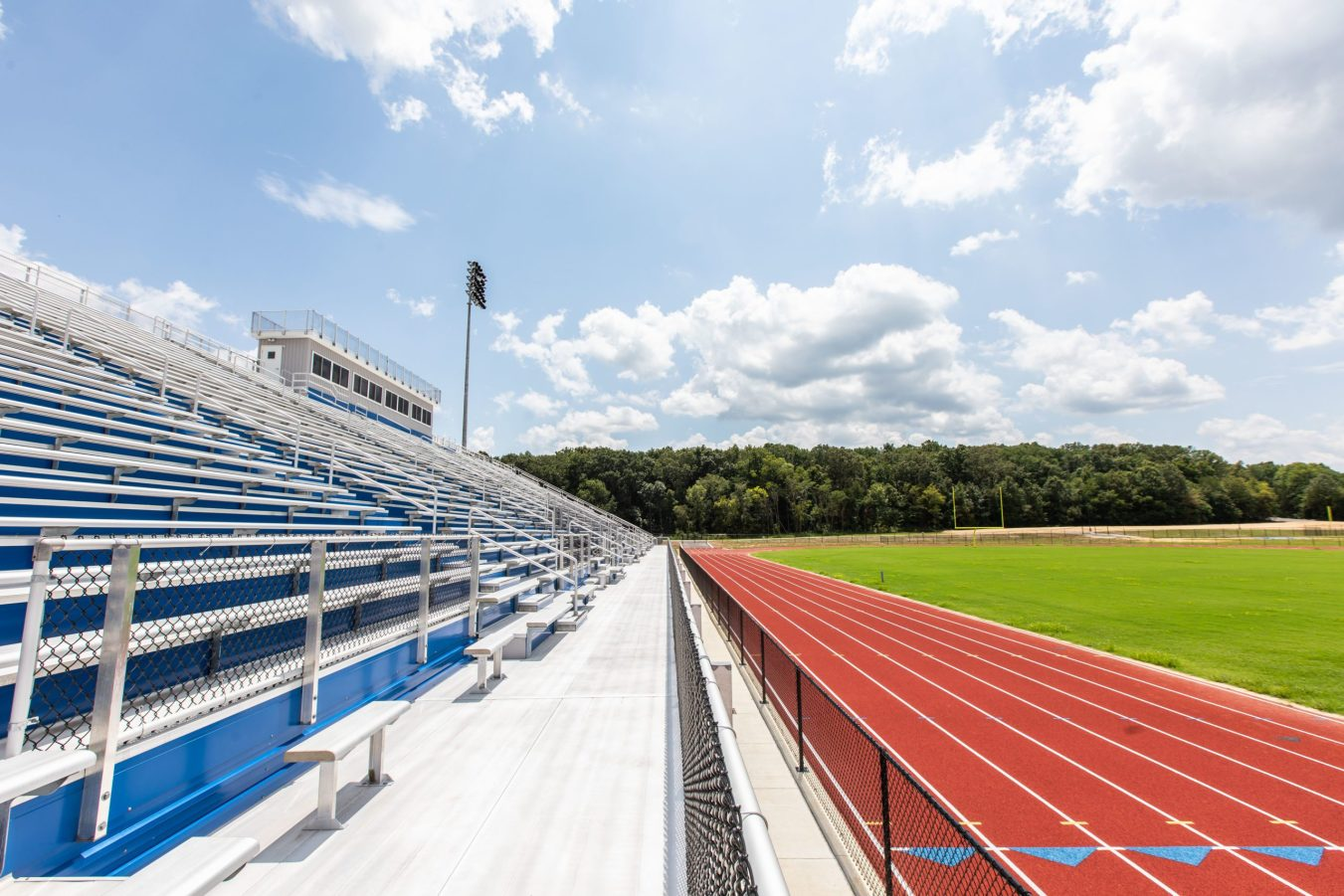 Track field with stadium stand