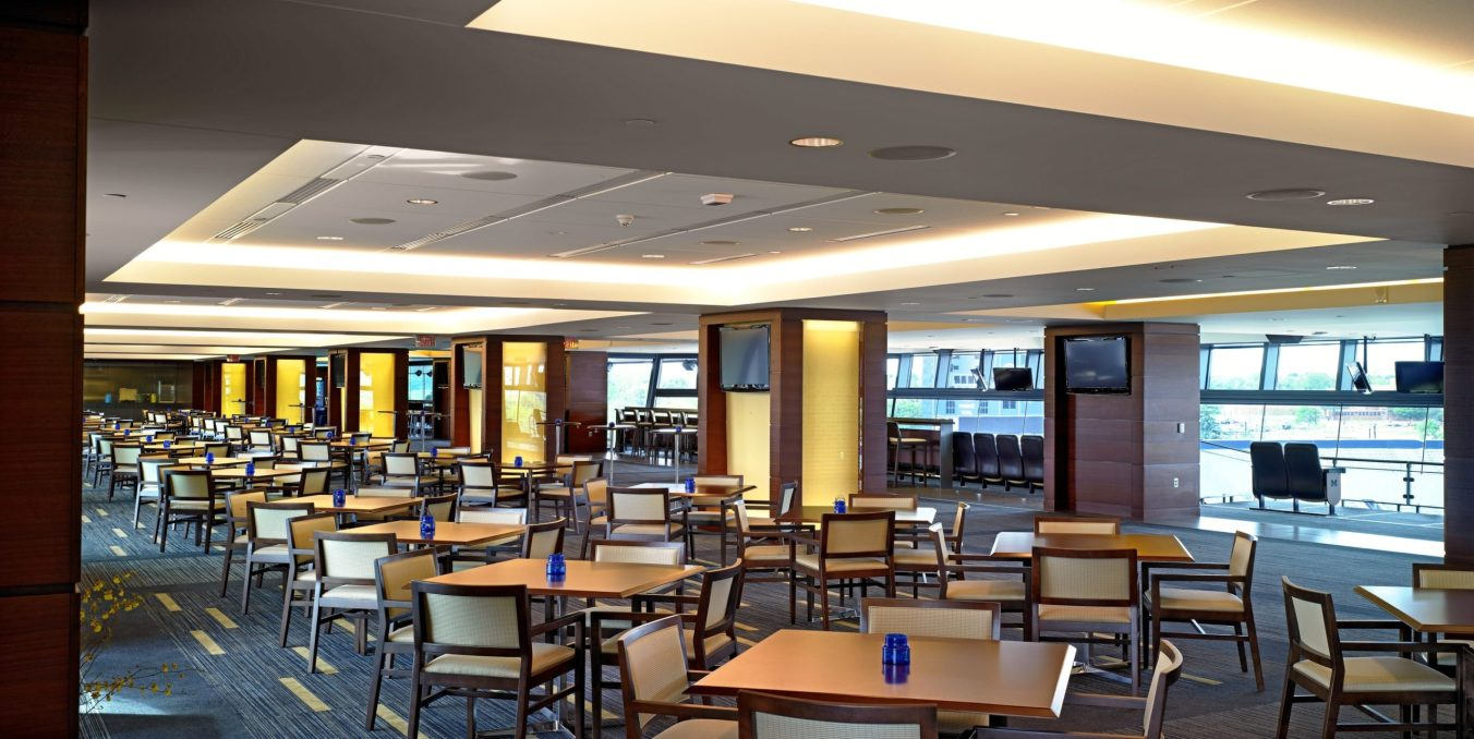 Dining tables and seats in interior concourse club area
