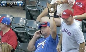 rangers_fan_catches_ball_casually_keeps_talking_on_cell_phone