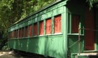 Oude wagon van de Standard Fruit Company in het park van La Ceiba