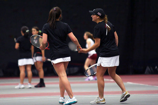 Meg Anderson '12 and Elena Mandzhukova '15 (right) have become Bates' first women selected to play in the NCAA Division III Women's Tennis Championship, at doubles. (Bates Tennis Blog file photo)
