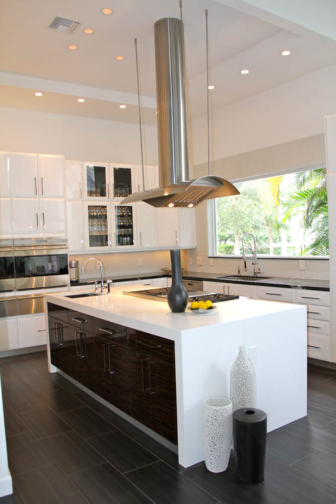 The floor planks are of a lighter teak wood finish. Contemporary Kitchen Design | Bath & Kitchen Creations | Palm Beach