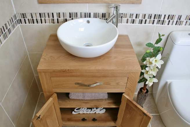Above Close View of Round Curved White Ceramic Basin on Oak Vanity Unit with Open Doors