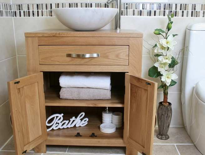 Front View of White Marble Basin on Single Oak Top Vanity - Showing Storage