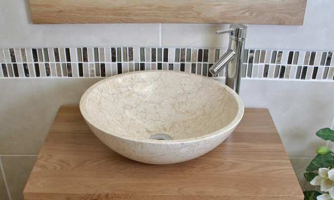 Close-Up of Cream Marble Basin on Oak Top