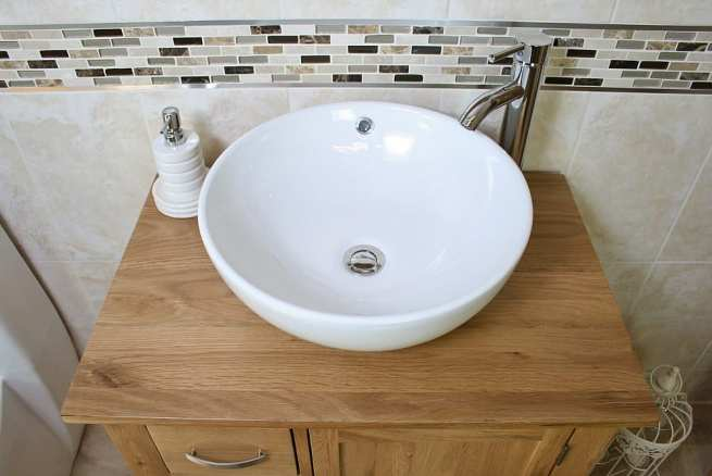 Above View of White Ceramic Round Curved Bathroom Basin on Oak Top Vanity Unit