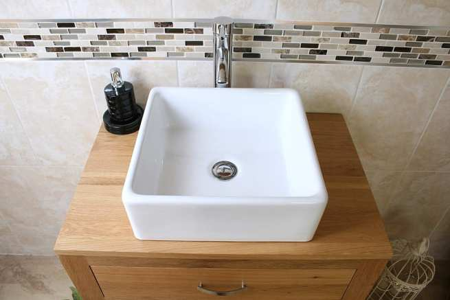 Above Close-Up of Square White Ceramic Basin on Oak Top