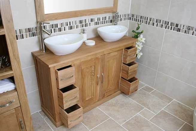 Two Oval White Ceramic Basins on Large Oak Top Vanity Unit with Open Drawers