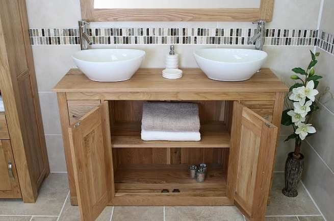 Double White Oval Ceramic Basins on Oak Top Vanity Unit with Open Doors