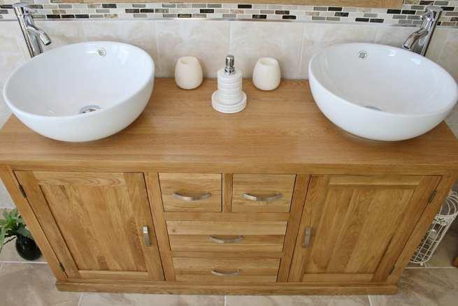 Close-UpView of Two White Ceramic Round Basins on Large Oak Vanity Unit