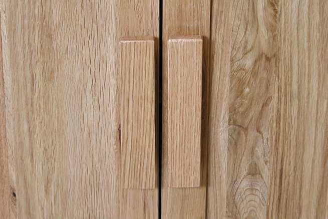 Oak wooden handles on vanity unit doors