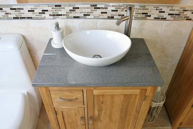 Above View of White Ceramic Oval Basin on Grey Quartz Top Vanity Unit