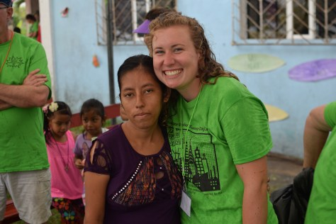 May pictured alongside a member of the local Belizean community.