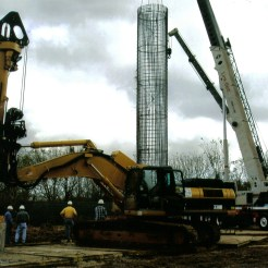 """Lowering 102"""" x 60' cage: Liverpool, TX"""