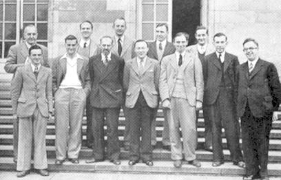 Front row, left to right: R.G. Wade, F. Parr, W. Winter, R.F. Combe, C.H.O'D. Alexander, H. Golombek, G. Abrahams Behind: G. Wood, R.J. Broadbent,