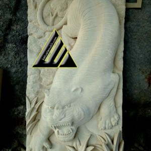 batu ukir relief motif harimau