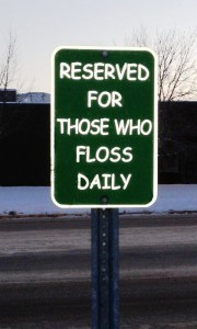 floss daily, parking sign