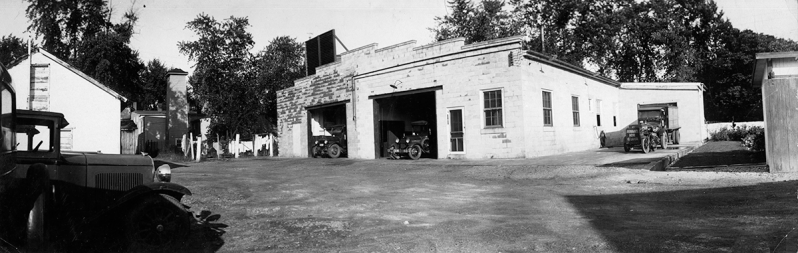 PHOTO SHOWS ANOTHER VIEW OF THE NEUMAN ICE CREAM PLANT BEFORE THE FIRE COMPANY PURCHASE OF THE PROPERTY WITH ACCESS TO MAIN AND BOND STREETS VIA THE ALLEY. THE REAR OF THE MAIN STREET FIRE STATION AND HOSE TOWER CAN BE SEEN ON THE LEFT BETWEEN THE BUILDINGS
