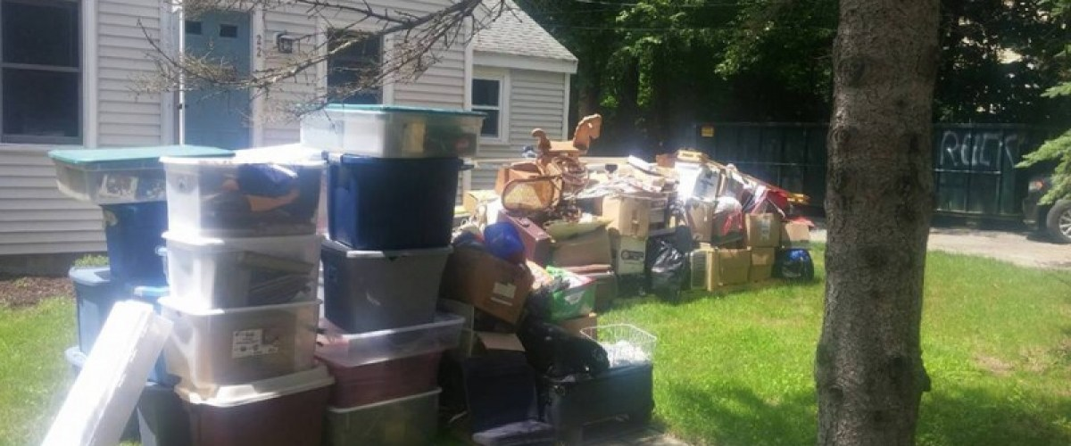 Moldy belongings drying in front yard