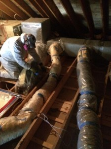 Crew member removing attic mold