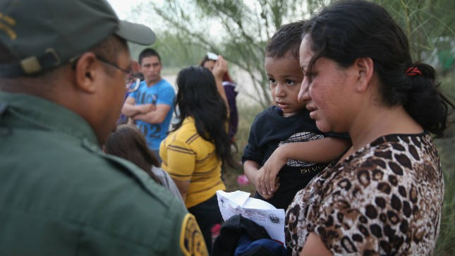 Hundreds of illegal immigrants rounded up in America, as raids begin