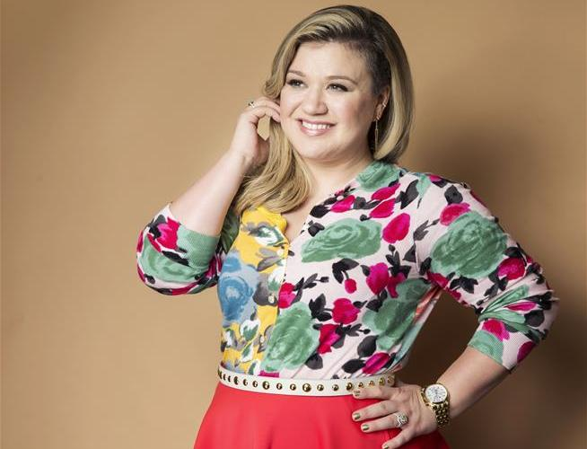 Kelly Clarkson:  I've been blackmailed by my label into working with Dr. Luke