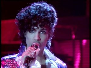 Prince in his Little Red Corvette video.