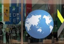 OECD slightly lowers global economic growth projection for 2021 2