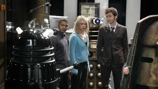 The Doctor, Rose and Mickey with Daleks