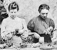 Two Victorian woman at work in a hat factory
