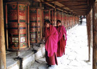 Tibetan monks use a prayer wheel