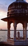 Hindu shrine in Delhi, India, at sunrise looking out over the waters