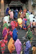 Indian women and children climbing the steps to a temple